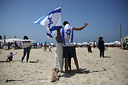 People take a selfie during Independence Day celebrations on the beach in Tel-Aviv, Israel April 15, 2021. People gathered in their masses at Tel-Aviv's shore line as the Jewish state celebrates 73 years to it's establishment. As vast percentage of the population are vaccinated, celebrations were able to take place in a some what ordinary manner.Starting Sunday April 18, 2021, it will no longer be mandatory to wear a protective mask in open spaces throughout the country.