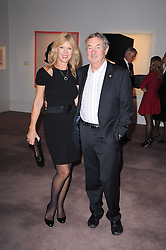 NICK & NETTE MASON at the Krug Mindshare auction held at Sotheby's, New Bond Street, London on 1st November 2010.