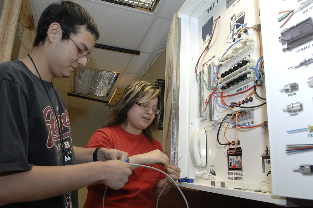 Houston, Texas March 5, 2007: Student learn home wiring techniques at the George Washington Carver Magnet High School for science and technology in the Aldine school district of Houston.      ©Bob Daemmrich/