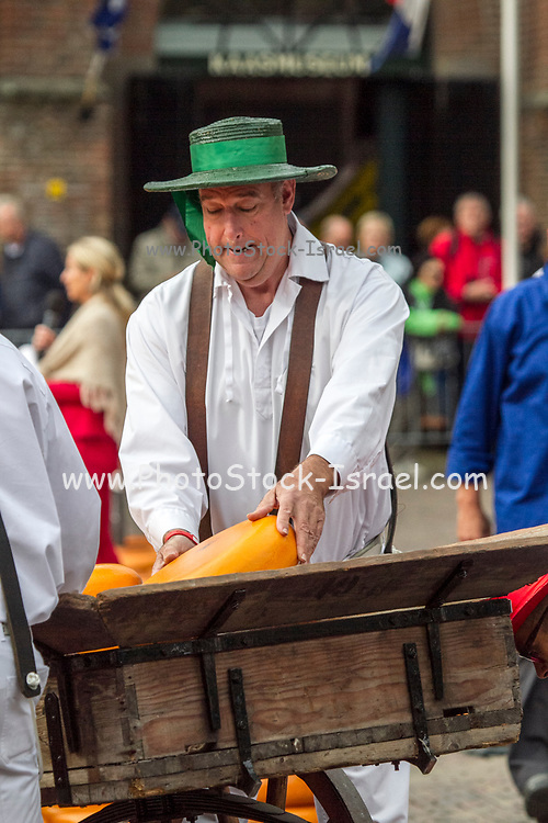Cheese vendors in traditional costume at Alkmaar Cheese Market, Netherlands