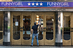 © Licensed to London News Pictures. 12/05/2016. Cleaner cleaning windows of the Savoy theatre. Announcement of actress SHERIDAN SMITH absent from stage play Funny Girl playing the lead role of Fanny Brice due to indisposition London, UK. Photo credit: Ray Tang/LNP