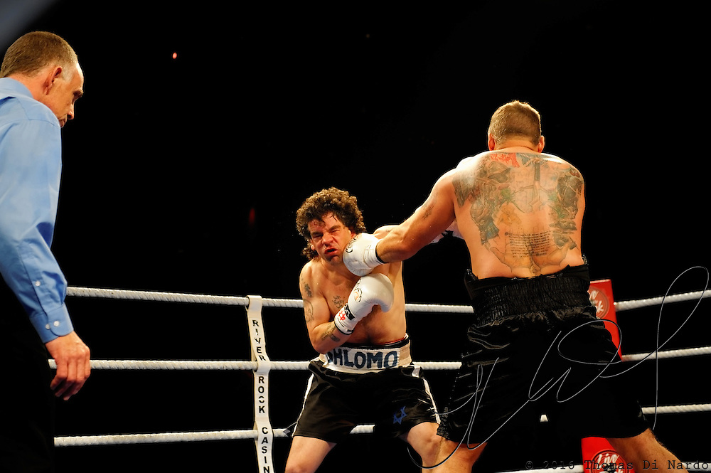 June 19, 2009 - Richmond, BC - Rumble at the Rock IV - Heavyweight fighters Jaime Walton of Burnaby, BC, and Brad McPeake of Vancouver trade punches during their four round non-title bout. The heavyweight four round event between Walton (3-1) and McPeake (1-11-2) ended at 1:35 of the second round with Walton winning on a TKO.