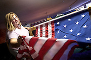 """Debbi Nadrchal, the Lodge Secretary for Elks Lodge 1254 in Coeur d'Alene, unfurls a 15-star flag on Saturday in preparation for Monday's Flag Day celebration. This particular design of the flag, which inspired Francis Scott Key to write """"The Star Spangled Banner,"""" was created in 1795 to acknowledge the admission of Vermont and Kentucky to the Union."""