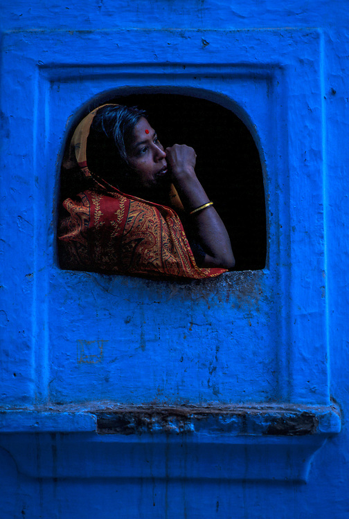 Resident looking out of her window, Jodhpur old town