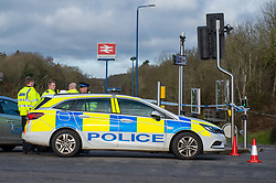 © Licensed to London News Pictures. 25/02/2020. Gerrards Cross, UK. Police maintain a cordon at the entrance to Gerrards Cross train station after an ATM at a Barclays Bank was targeted in an overnight robbery. Photo Credit: Peter Manning/LNP