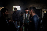 A group of young migrants are ready to leave the makeshift camp next to the train station to move to in one of the govermanet camp. They don't tollerate anymore the conditions of the camp, too dirty and without a real protection from the weather and smugglers. March 17th, 2017, Belgrade, Serbia. Federico Scoppa