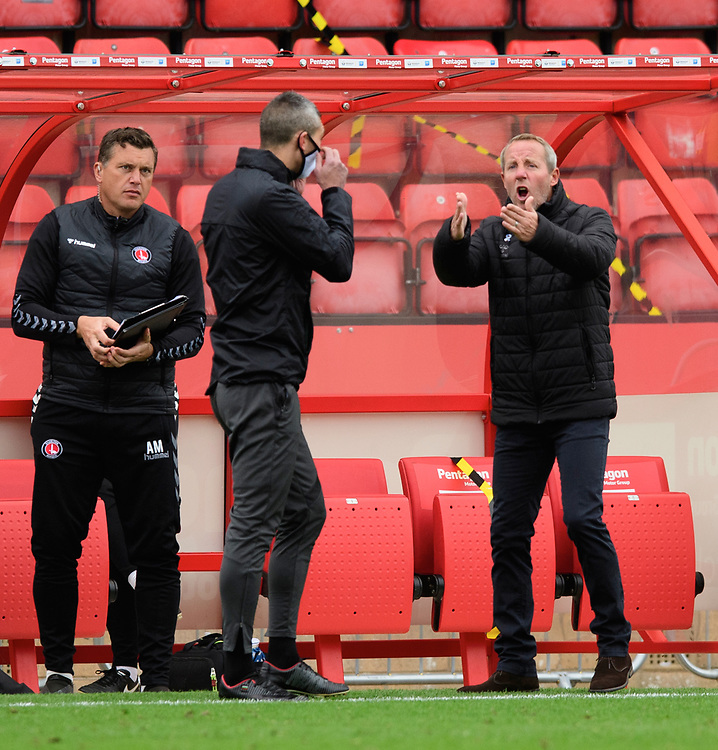 Charlton Athletic manager Lee Bowyer, right, questions Fourth Official Hristo Karaivanov after Referee Marc Edwards' decision to award a goal scored by Lincoln City's Jorge Grant<br /> <br /> Photographer Chris Vaughan/CameraSport<br /> <br /> The EFL Sky Bet League One - Lincoln City v Charlton Athletic - Sunday 27th September, 2020 - LNER Stadium - Lincoln<br /> <br /> World Copyright © 2020 CameraSport. All rights reserved. 43 Linden Ave. Countesthorpe. Leicester. England. LE8 5PG - Tel: +44 (0) 116 277 4147 - admin@camerasport.com - www.camerasport.com