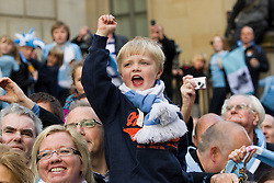 © licensed to London News Pictures. Manchester, UK  23/05/2011. Tens of thousands of fans line the streets of Manchester as Manchester City Football Club hold an open-topped bus parade through the city. The team are celebrating winning the FA Cup, their first trophy in 35 years, and for qualifying for next season's Champions League. Please see special instructions for usage rates. Photo credit should read Joel Goodman/LNP