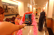 Moina Janely, age, 9, center, pushes her chemo down the hall as Eileen Brazil, right,  leaves the Pediatrics Prom at Memorial Sloan-Kettering Cancer Center in Manhattan, NY. 6/7/2005 Photo by Jennifer S. Altman