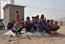 Iraqi kids in the refugees camp of UNHCR in Zelican, North of Mosul, Kurdistan Region of Iraq on October 25, 2016. UNHCR is stepping up its preparations to receive those displaced by the fighting to retake Iraqís second city, Mosul. Photo by Mathieu Redoube/ABACAPRESS.COM