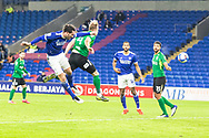 Cardiff City's Sean Morrison (4) heads towards goal during the EFL Sky Bet Championship match between Cardiff City and Birmingham City at the Cardiff City Stadium, Cardiff, Wales on 16 December 2020.
