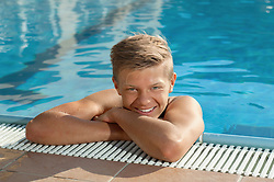 Portrait happy boy swimming pool holiday relaxing