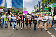 24 MAY 2014 - BANGKOK, THAILAND: Thai anti-coup / pro-democracy protestors march up Phahon Yothin Street towards Democracy Monument in Bangkok. There were several marches in different parts of Bangkok to protest the coup that unseated the popularly elected government. Soldiers and police confronted protestors and made several arrests but most of the protests were peaceful. The military junta also announced that firing of several police commanders and dissolution of the Thai Senate. The junta also changed its name from National Peace and Order Maintaining Council (NPOMC) to the National Council for Peace and Order (NCPO).   PHOTO BY JACK KURTZ