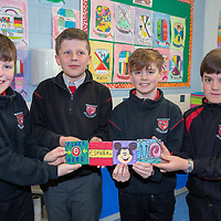 Cian Nugent, Alex Nagle, Alex Gallagher and Gonzalo Esparrago from Ennis National School Mr Corry's Class with samples of their project Colourful Coasters