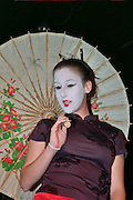 A female model in her 20s dressed as a Japanese with white make up