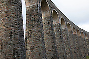 Cynghordy Viaduct in Llandovery, Wales, United Kingdom. Cynghordy Viaduct is a grade II listed 18-arch viaduct spanning the Afon Bran valley on a gentle curve. It is 31m high and 259m long and was built from sandstone and brick between 1867 and 1868.