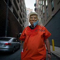 An activist dresses as President Donald Trump wearing a prison jump suit after Democratic presidential nominee Joe Biden overtook Trump in the Pennsylvania general election vote count across the street from where ballots are being counted, three days after the 2020 U.S. presidential election, in Philadelphia, Pennsylvania, U.S. November 6, 2020. REUTERS/Mark Makela