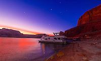 A 75 foot luxury-class houseboat anchored along Lake Powell at twilight, Glen Canyon National Recreation Area, Arizona/Utah border USA