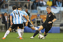 03.07.2010, CAPE TOWN, SOUTH AFRICA, im Bild .Bastian Schweinsteiger of Germany attempts to get past Javier Mascherano of Argentina and Sergio Aguero of Argentina during the Quarter Final, Match 59 of the 2010 FIFA World Cup, Argentina vs Germany held at the Cape Town Stadium..Foto ©  nph /  Kokenge