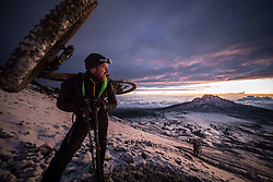 Scotthis Danny MacAskill looks back and enjoys the sunrise on around 5400 m / 17700ft above sea level on this way up to the peak of Kilimanjaro.
