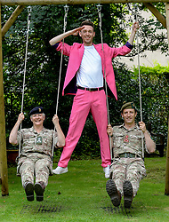 Pictured: Brigadier Suzanne Anderson and Brigadier Robin Lindsay Commander 51 Brigade pushed by performer Nick Alban from show The Happiness Project.<br /> <br /> The Army at the Fringe venue opened it's doors today, with five shows on. <br /> <br /> © Dave Johnston / EEm