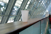 plastic cup on railing at a business conference center
