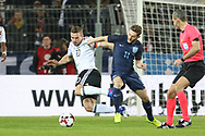 Lukas Podolski of Germany battles with Adam Lallana of England during the International Friendly match between Germany and England at Signal Iduna Park, Dortmund, Germany on 22 March 2017. Photo by Phil Duncan.