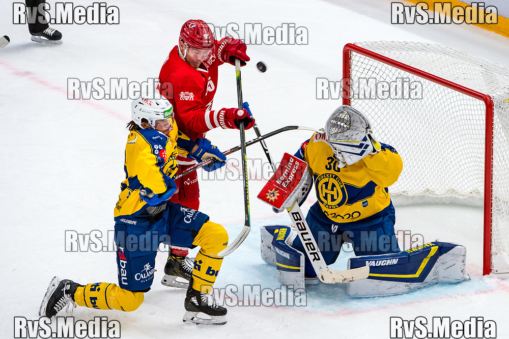 LAUSANNE, SWITZERLAND - NOVEMBER 05: #95 Tyler Moy of Lausanne HC tries to score against #30 Goalie Joren van Pottelberghe and #23 Samuel Guerra of HC Davos during the Swiss National League game between Lausanne HC and HC Davos at Vaudoise Arena on November 5, 2019 in Lausanne, Switzerland. (Photo by Robert Hradil/RvS.Media)