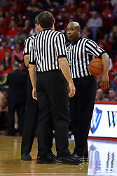 26 November 2016:  Paul Janssen (back), Jeb Hartness (hidden) and Ervin Wilson discuss a double technical foul situation during an NCAA  mens basketball game between the Ferris State Bulldogs the Illinois State Redbirds in a non-conference game at Redbird Arena, Normal IL
