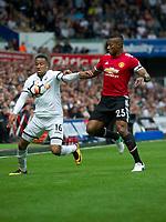 Football - 2017 / 2018 Premier League - Swansea City vs. Manchester United<br /> <br /> Martin Olsson of Swansea City & Antonio Valencia of Manchester United—<br /> , at Liberty Stadium.<br /> <br /> COLORSPORT/WINSTON BYNORTH