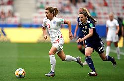 England's Karen Carney (left) and Scotland's Chloe Arthur (right) battle for the ball