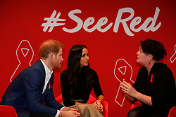 Prince Harry and Meghan Markle take part in a discussion with HIV consultant doctor Laura Waters (right) at a Terrence Higgins Trust World AIDS Day charity fair, during a visit to the Nottingham Contemporary in Nottingham, on their first official engagement together.