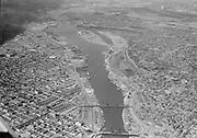 "Ackroyd 06281-1. ""August 22, 1950"" Portland lower harbor. Broadway bridge to Swan Island."