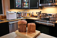 Loaves of Hearty Whole Wheat & Rye Bread. Image taken with a Leica CL camera and 18 mm f/2.8 lens (ISO 1000, 18 mm, f/2.8, 1/50 sec).