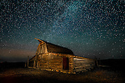 The Milky Way and stars over the North Moulton Barn in Grand Teton National Park.