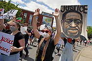 """A protesters holds up their hands as a George Floyd is shown while hundreds of protesters turned out June 7, 2020, for a Black Lives Matter """"Circle of Peace"""" protest at Centre Square in Easton, Pennsylvania. (Photo by Matt Smith)"""