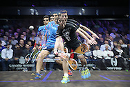a multiple exposure image as Mathieu Castagnet of France (wearing Black shirt) hits a shot against Omar Mosaad of Egypt (wearing light Blue shirt) the Final, Omar Mosaad of Egypt v Mathieu Castagnet of France , Canary Wharf Squash Classic 2016 , at the East Wintergarden in Canary Wharf , London on Friday 11th March 2016.<br /> pic by John Patrick Fletcher, Andrew Orchard sports photography.