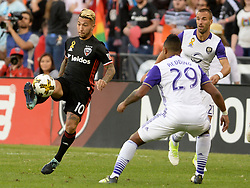 September 9, 2017 - Washington, DC, USA - 20170909 - D.C. United midfielder LUCIANO ACOSTA (10) gains control of the ball against Orlando City FC defender TOMMY REDDING (29) and Orlando City FC defender SCOTT SUTTER (21) in the first half at RFK Stadium in Washington. (Credit Image: © Chuck Myers via ZUMA Wire)