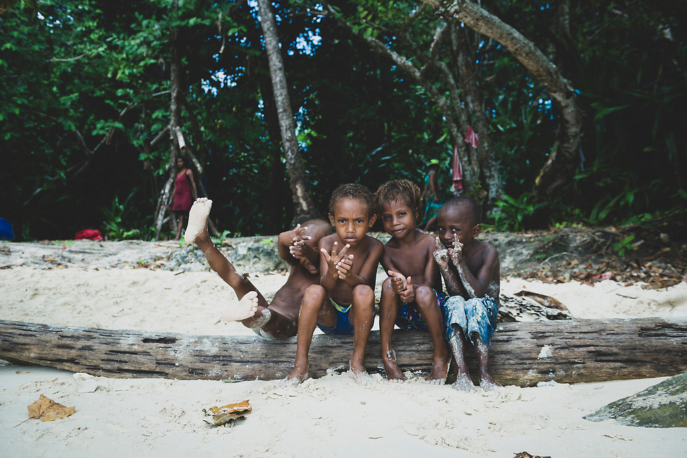 Kids at the beach on Pig Island, a small island located near the town of Madang in Papua New Guinea.<br /><br />(August 1, 2017)