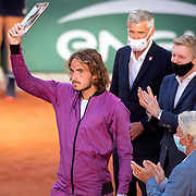 PARIS, FRANCE June 13.   Former Roland Garros champions Bjorn Borg and Jim Courier present the runners-up trophy to Stefanos Tsitsipas of Greece watched by  FFT President Gilles Moretton after his loss against Novak Djokovic of Serbia during the Men's Singles Final at the 2021 French Open Tennis Tournament at Roland Garros on June 13th 2021 in Paris, France. (Photo by Tim Clayton/Corbis via Getty Images)