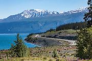 North America, Canada, Yukon Territory, Destruction Bay, Kluane National Park and Reserve.  View of Alaska Highway and Vulcan Mountain of the Kluane Mountain Range