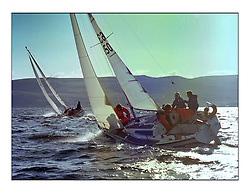 The Clyde Cruising Club's 1977 Tomatin Trophy the first Scottish Series held at Tarbert Loch Fyne.  An overnight race from Gourock to Campbeltown then on to Olympic Triangles in Loch Fyne. ..The start of the overnight race at Gourock, K6350 Limbus owned at the time by A Poole..