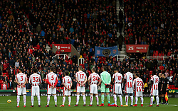 Stoke City pause for a minutes silence during the Premier League match at the bet365 Stadium, Stoke-on-Trent.