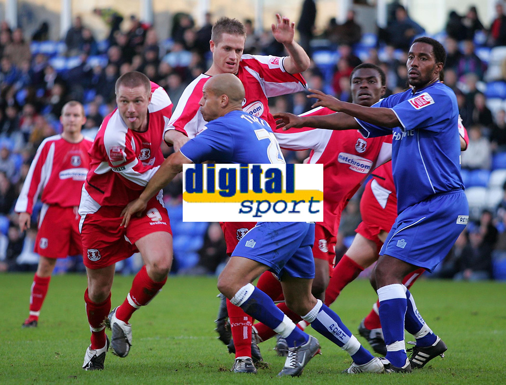 Photo: Frances Leader.<br />Peterborough Utd v Leyton Orient. Coca Cola League 2.<br />12/11/2005.<br />Pushing and shoving as a free kick at goal is taken by Orient.