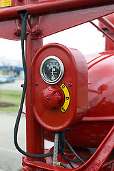 04 May 2013:   Arranged to coincide and be a part of the Red Corridor Route 66 festival, the village of Lexington hosts an antique tractor show.  Roger Whaley is the chairman of the organizing committee.  1950 Model M Farmall, amp gauge and control knob.