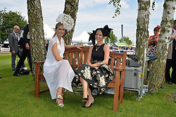Left to right, VOGUE WILLIAMS and ALEXANDRA LIGHT at the Investec Ladies Day at the Investec Derby Festival 2015 at Epsom Racecourse, Epsom, Surrey on 5th June 2015.