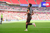 Lincoln City's Brennan Johnson celebrates after his cross was diverted into the net, to score the opening goal of the game, by Blackpool's Oliver Turton<br /> <br /> Photographer Chris Vaughan/CameraSport<br /> <br /> The EFL Sky Bet League One Play-Off Final - Blackpool v Lincoln City - Sunday 30th May 2021 - Wembley Stadium - London<br /> <br /> World Copyright © 2021 CameraSport. All rights reserved. 43 Linden Ave. Countesthorpe. Leicester. England. LE8 5PG - Tel: +44 (0) 116 277 4147 - admin@camerasport.com - www.camerasport.com