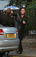"""MICHAEL MADSEN MESSING ABOUT OF CAMERA  FOR THE PHOTO ON SET """"RED RIVER RUNS"""" IN HOLBURN CENTRAL LONDON"""