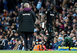 West Ham United's Cheikhou Kouyate is substituted off the pitch after picking up an injury during the Premier League match at the Etihad Stadium, Manchester.