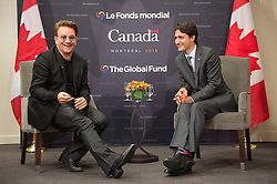 Prime Minister Justin Trudeau listens to Bono during a meeting at the Global Fund conference Saturday, on September 17, 2016 in Montreal, QC, Canada. Photo by Paul Chiasson/The Canadian Press/ABACAPRESS.COM